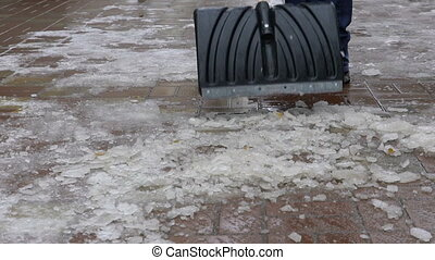 Footage man cleans snow from the yard shovel. slow motion ...