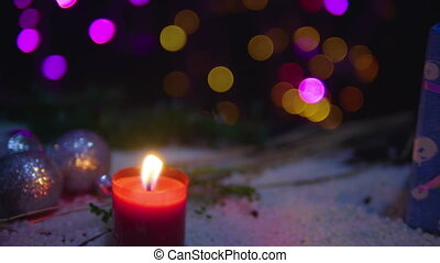Footage moving of candle burning, balls, and gift with lamp shiny. Christmas
