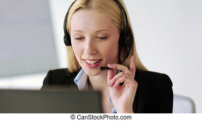 attractive helpline operator in office - footage of...