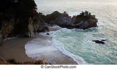 Footage of beautiful ocean bay surrounded by high cliffs at...