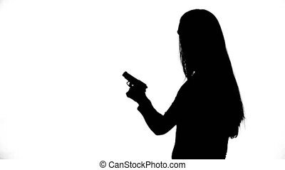 Footage of beginner with gun - Footage of woman's isolated...