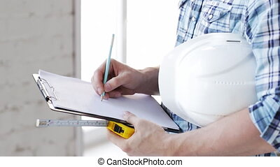 builder with measuring tape on site - footage of builder...