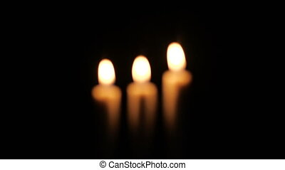 Footage of closeup of candle on black background. Christmas