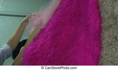 Footage of colour caracul coat in the workshop