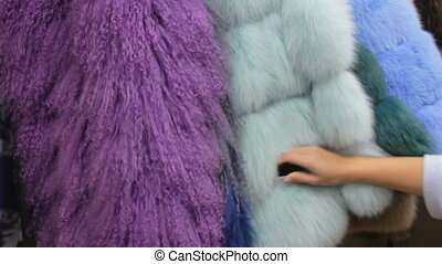 Footage of colour furry coats in the workshop