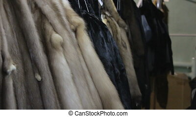 Footage of hanging mink's pelts in the workshop