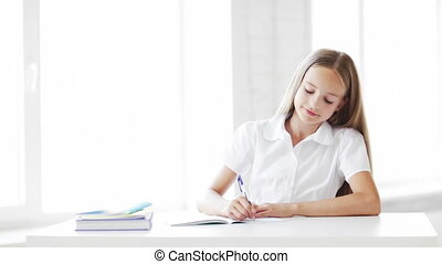 happy student girl making homework - footage of happy...