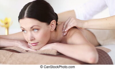 happy woman relaxing in spa salon