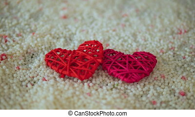 Footage of heart decoration on sand for Valentine day