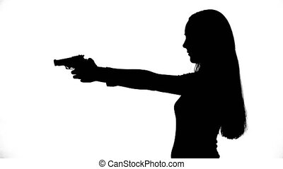 Footage of isolated girl with gun - Footage of woman's...