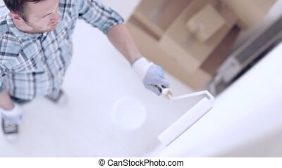 man painting with white paint - footage of man painting with...