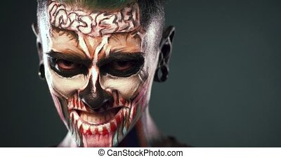 Footage of man with mystical makeup. Face art concept,...