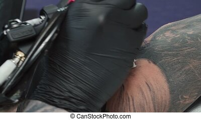 Footage of master making tattoo in salon - Video of man ...
