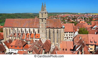 Footage of old european town with red roof tops from high...