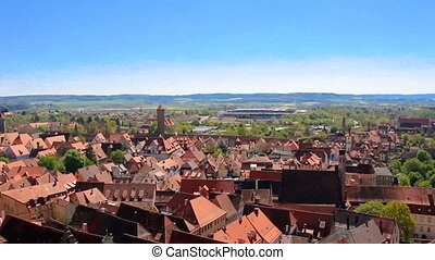 Footage of old european town with tiled red roof tops at...