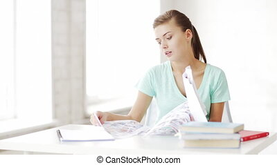 pretty female student doing homework