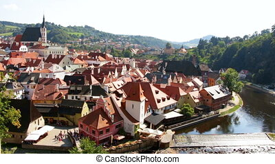 Footage of small river flowing through old european town at...
