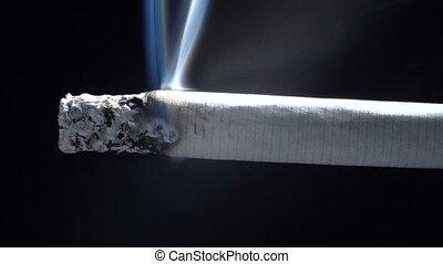 Video of smoldering cigarette on black background