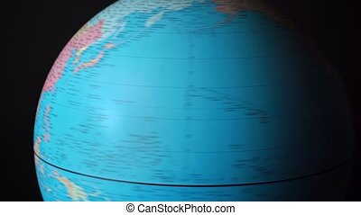 Footage of spinning around political globe with countries - ...