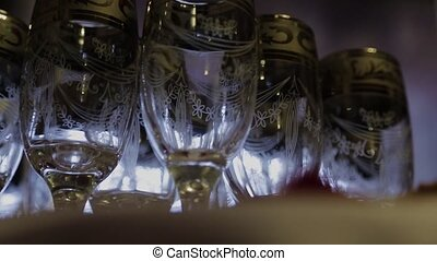 Footage of stylish wine glasses for wine tasting in fine dining winery with wine on table