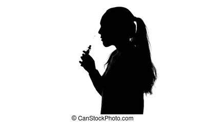 Footage of teenage girl with vape - Footage of young woman...