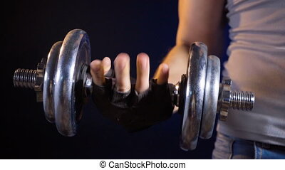 Footage of training man with dumbbell