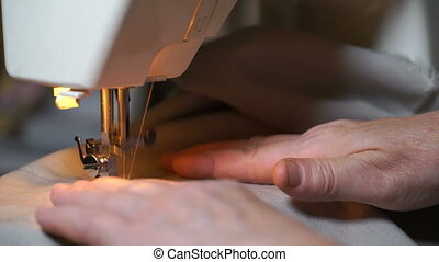 footage of woman sews on the sewing machine. 4K