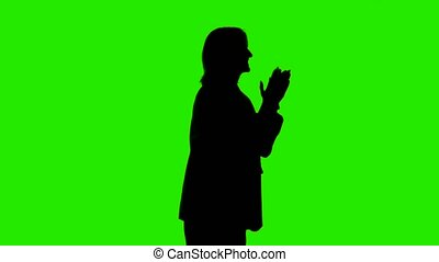Footage of woman's silhouette in suit jacket with applause on green background