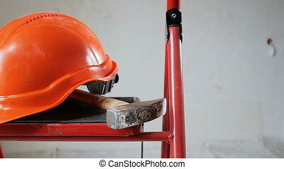 Footage of working tools and red helmet at apartment under renovation. Concept of building
