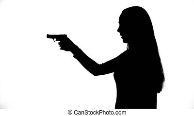 Footage of young girl with gun - Footage of woman's isolated...