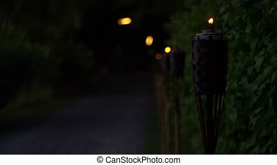 Footage Torch lights the road. - Footage Torch lights the...