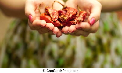 footage Woman holding a dried red peppers close up. 4K
