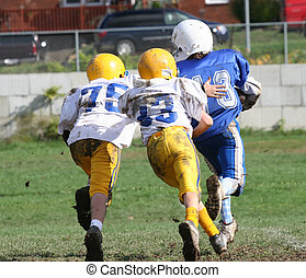 Teen Youth Football Action in Play
