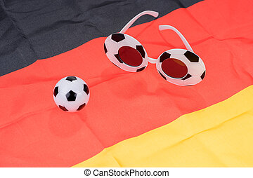 Football and abstract glasses on the german flag