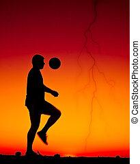 football at sunset