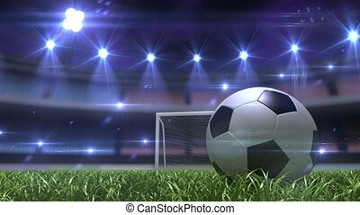 Football background, soccer ball on the grass at night stadium. 3d animation
