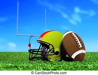 Football Ball and Helmet on Grass