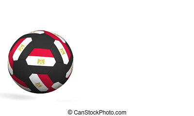 Football ball featuring flags of Egypt. Alpha matte for easy...