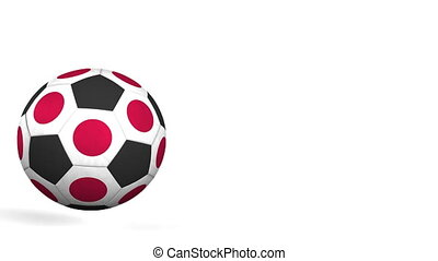 Football ball featuring flags of Japan. Alpha matte for easy...