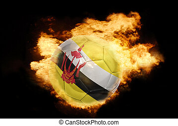 football ball with the flag of brunei on fire