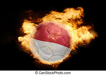 football ball with the flag of indonesia on fire
