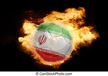 football ball with the flag of iran on fire