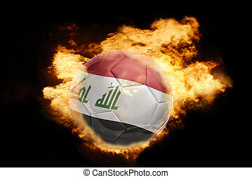 football ball with the flag of iraq on fire