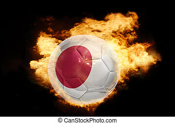 football ball with the flag of japan on fire