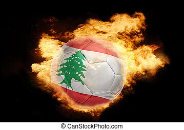 football ball with the flag of lebanon on fire