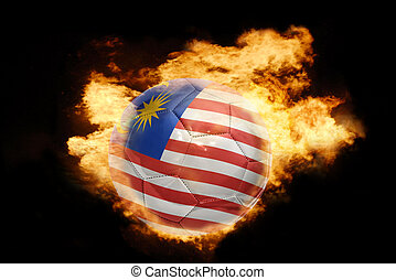 football ball with the flag of malaysia on fire