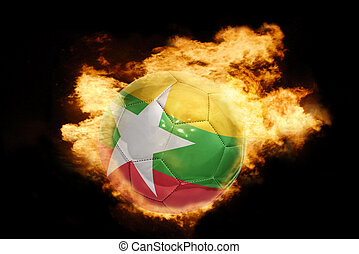 football ball with the flag of myanmar on fire