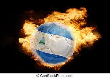 football ball with the flag of nicaragua on fire
