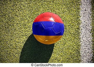 football ball with the national flag of armenia lies on the field