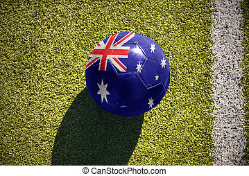 football ball with the national flag of australia lies on the field